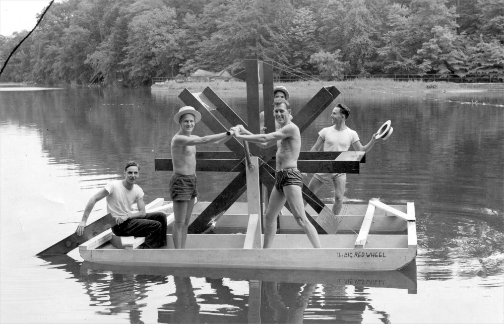 Students work a paddlewheel float on Beebe Lake